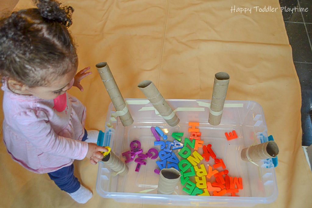 Alphabet drop is a toddler literacy and fine motor activity